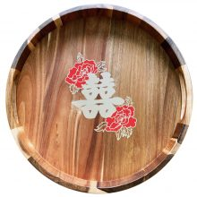 <strong>Double Happiness</strong><br><br>Traditional Double Happiness symbol (囍) hand painted on a wooden tray for a wedding tea ceremony. Tea is offered as a sign of respect and peonies were added to represent royalty and virtue. The Double Happiness ligature is composed of 喜喜 – which are two adjacent copies of the Chinese character 喜, which means joy. Commission.<br><br>Paint on acacia wood. 2 inches high x 15 inches diameter